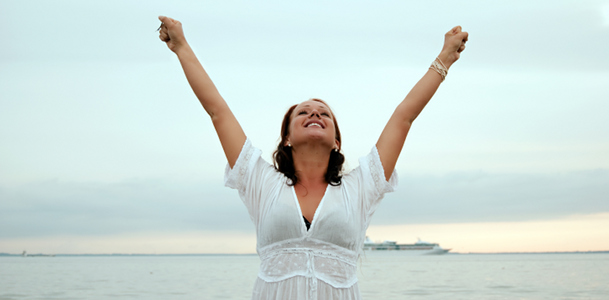 Happy Woman Raising Arms