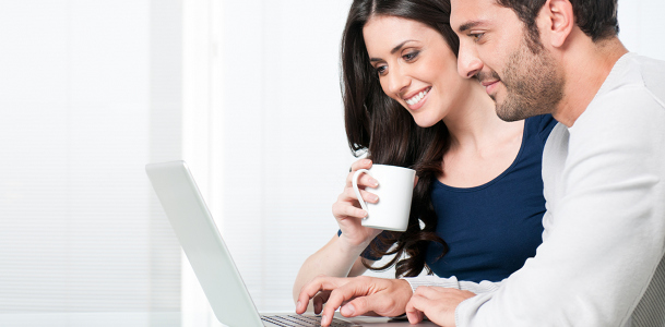 Happy Young Couple on Laptop