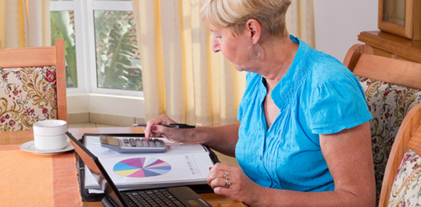 Woman Working on Home Budget